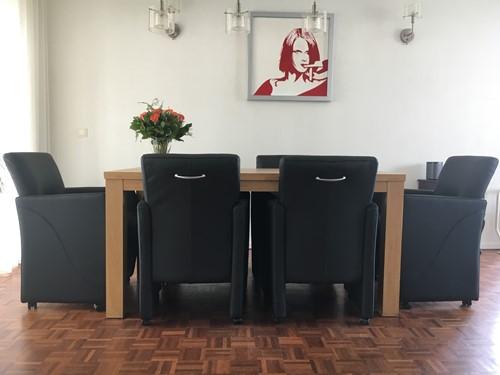 Set van 6 leren eetkamerfauteuils - met armleuning en wieltjes - zwart leer