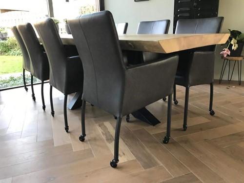 Set van 8 leren eetkamerstoelen - met wieltjes en armleuning - zwart leer